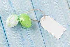 Wielkanocni jajka i pusta etykietka Zdjęcie Royalty Free