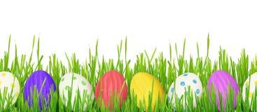 Wielkanocni jajka i trawy granica Obrazy Stock