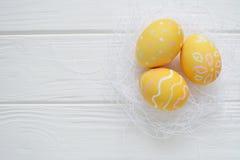 Wielkanocni jajka malujący w pastelowych kolorach Obraz Royalty Free