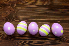 Wielkanocni jajka na drewnianym tle Fotografia Royalty Free