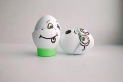Wielkanocni jajka szczęśliwi z twarzy pojęciem roześmiany grzech zdjęcie royalty free