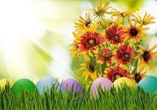 Wielkanocni jajka w trawie i kwiatach Obraz Stock