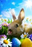 Sztuki Easter dziecka królik i Easter jajka Zdjęcia Royalty Free