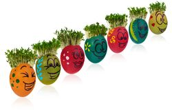 Wielkanocny jajko malujący w śmiesznej smiley dziewczyny twarzy kolorowym patt i Zdjęcie Royalty Free