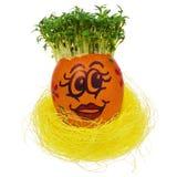 Wielkanocny jajko malujący w śmiesznej smiley twarzy kolorowych wzorach i Zdjęcie Royalty Free