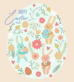 Wielkanocny kartka z pozdrowieniami z ślicznymi królikami i jajkami Zdjęcie Royalty Free
