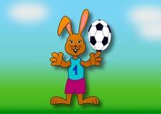 Wielkanocny królik jako gracz piłki nożnej Fotografia Royalty Free