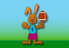 Wielkanocny królik jako rugby gracz Zdjęcie Royalty Free