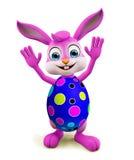 Wielkanocny królik z colourful jajkami mówi pozę cześć Fotografia Royalty Free