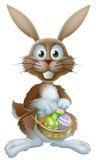 Wielkanocny królik z czekoladowymi jajkami Fotografia Royalty Free