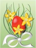 Wielkanocny temat z czerwonym jajkiem i daffodils Obrazy Royalty Free