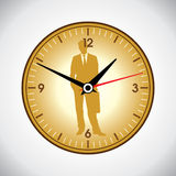Wielki żółty ścienny zegar i biznesowy mężczyzna Fotografia Royalty Free