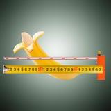 Wielki banan i pomiarowa taśma Fotografia Royalty Free
