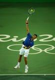 Wielkiego Szlema mistrz Novak Djokovic Serbia w akci podczas mężczyzna ` s przerzedże pierwszy round dopasowanie Rio 2016 olimpia Zdjęcia Royalty Free