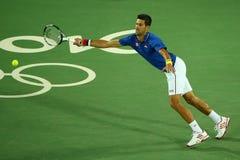 Wielkiego Szlema mistrz Novak Djokovic Serbia w akci podczas mężczyzna ` s przerzedże pierwszy round dopasowanie Rio 2016 olimpia Obraz Royalty Free