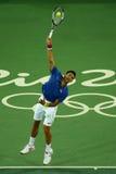 Wielkiego Szlema mistrz Novak Djokovic Serbia w akci podczas mężczyzna ` s przerzedże pierwszy round dopasowanie Rio 2016 olimpia Obrazy Royalty Free