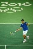 Wielkiego Szlema mistrz Novak Djokovic Serbia w akci podczas mężczyzna ` s przerzedże pierwszy round dopasowanie Rio 2016 olimpia Zdjęcie Stock