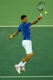 Wielkiego Szlema mistrz Novak Djokovic Serbia w akci podczas mężczyzna ` s przerzedże pierwszy round dopasowanie Rio 2016 olimpia Obrazy Stock