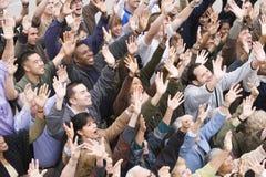 Wielo- Etniczni ludzie Podnosi ręki Wpólnie Obraz Royalty Free