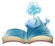 Wieloryb i książka Obraz Royalty Free
