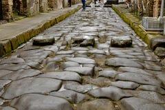 Wielsleur van wagens op oude straten van Pompei Stock Afbeelding