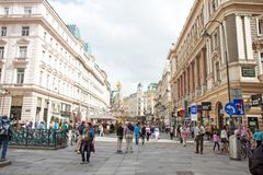Wien, Austria. WIEN - MAY 17, 2013: People is walking in Graben St., old town main street  of Vienna, Austria. The column on the background, called The Pestsaule Stock Images