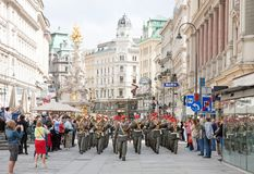 Wien, Austria. WIEN - MAY 17, 2013: The Town's band in  playing in Graben St., old town main street  of Vienna, Austria. The column, called The Pestsaule was Stock Photography