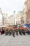Wien, Austria. WIEN - MAY 17, 2013: The Town's band in  playing in Graben St., old town main street  of Vienna, Austria. The column, called The Pestsaule was Stock Photo