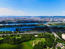 Wien city view. Skyline of Wien city from the Donauturm tower, Danube and gardens Royalty Free Stock Image