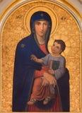 Wien - den Madonna målarfärgen av Josef Kastner det äldre från 20 cent i den kyrkliga Muttergotteskirchen arkivfoto