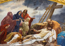 Wien - freskomålning av avlagring av corssna från entré av den Schottenkirche kyrkan Arkivbild