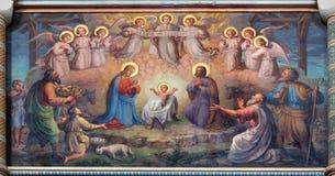 Wien - freskomålning av julkrubban av Josef Kastner från 1906 - 1911 i den Carmelites kyrkan i Dobling. Royaltyfria Bilder