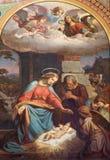 Wien - freskomålning av julkrubban av Karl von Blaas från. cent 19. i skepp av den Altlerchenfelder kyrkan Arkivfoto