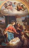 WIEN: Freskomålning av julkrubban av Karl von Blaas från 19 cent i skepp av den Altlerchenfelder kyrkan Arkivbild