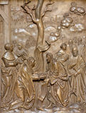 Wien - Jesus heilen die Frauensteinentlastung von der Rückseite der Kirche des Deutschen Ordens oder des Deutschordenkirche Lizenzfreie Stockfotografie
