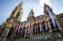 The Wiener Rathaus Vienna City Hall, Austria. At sunset, with austrian flags over the facade Royalty Free Stock Images