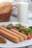 Wiener sausage. Wiener sausage with ketchup, mustard and salad Stock Photo
