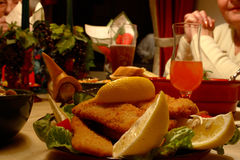 Wiener Schnitzel. Restaurant scene. Dinner with Wiener Schnitzel in a hotel restaurant stock photography