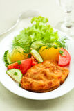 Wiener Schnitzel. With potatoes and fresh vegetables on a plate Stock Photography