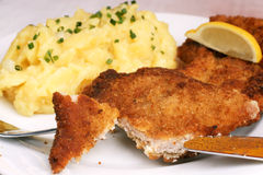 Wiener Schnitzel. With potato salad topped with chopped chives Royalty Free Stock Photo