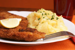 Wiener Schnitzel. With potato salad topped with chopped chives Royalty Free Stock Images