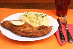 Wiener Schnitzel. With potato salad topped with chopped chives Stock Photos