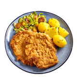 Wiener Schnitzel with boiled potatoes. And vegetable salad on grey dish shot from above isolated on white background royalty free stock photography