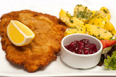 Wiener Schnitzel. Famous Wiener Schnitzel with side dish in Austrian restaurant Stock Photos