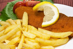 Wiener schnitzel. And french fries Stock Images