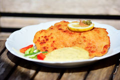 Wiener Schnitzel. With lemon and sauce on a table Stock Photos