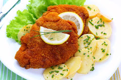 Wiener schnitzel with potato salad. And lemon Royalty Free Stock Photo