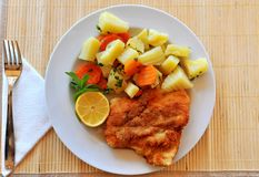 Wiener schnitzel. With potato salad and lemon Stock Images