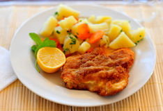 Wiener schnitzel. With potatoes and lemon on a plate Royalty Free Stock Photography