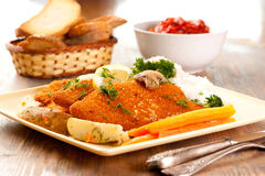 Wiener Schnitzels. Plate of Wiener Schnitzels with bread Royalty Free Stock Image